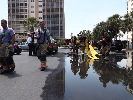 Firefighters responded to a smoke event in an elevator shaft at Creciente Condominiums on Fort Myers Beach on Tuesday, April 10, 2018. Multiple residents were evacuated.