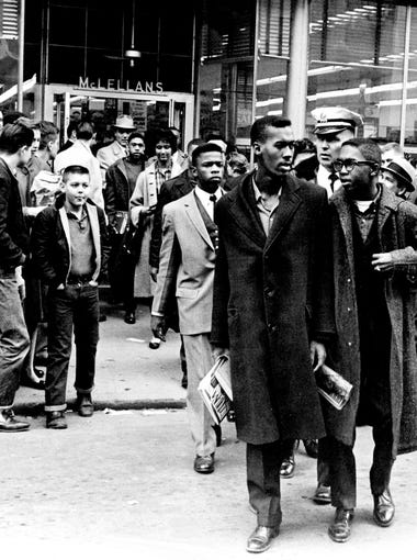 Black demonstrators, including John Lewis, center in light suit, are hustled out of McLellans Variety Store on Fifth Ave. N. downtown Nashville and off to jail after a four-hour demonstration against lunch counter segregation Feb. 27, 1960.