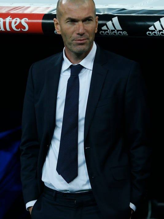 Real Madrid's new head coach Zinedine Zidane waits for the start of the game prior a Spanish La Liga soccer match between Real Madrid and Deportivo Coruna at the Santiago Bernabeu stadium in Madrid, Saturday, Jan. 9, 2016. (AP Photo/Francisco Seco)