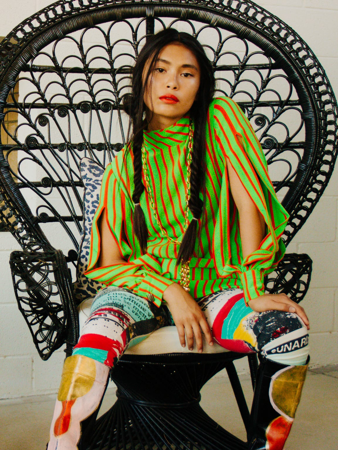 Silk shirt and gold necklace, at New/Found. Leggings, at Roxy Deluxe. Lily Yeung hand-painted boots, model's own.