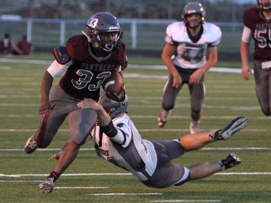 Lauren Roberts/Times Record News Seymour's David Watson breaks a tackle from a Hawley defender Friday, Sept. 30, 2016, at the Archer City athletic complex. The Bearcats defeated the Panthers 48-21.