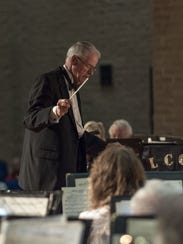 Richard Bradstreet conducts the 50-member Lee County Community Band.