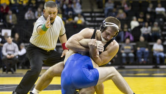 Iowa's Nick Moore wrestles Buffalo's Wally Maziarz at 165 pounds during the Hawkeyes wrestling meet in Iowa City on Thursday, December 12, 2013. Benjamin Roberts / Iowa City Press-Citizen