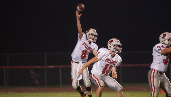 Harlan quarterback Hunter Kloewer passes the ball downfield against Dallas Center-Grimes on Sept. 19.