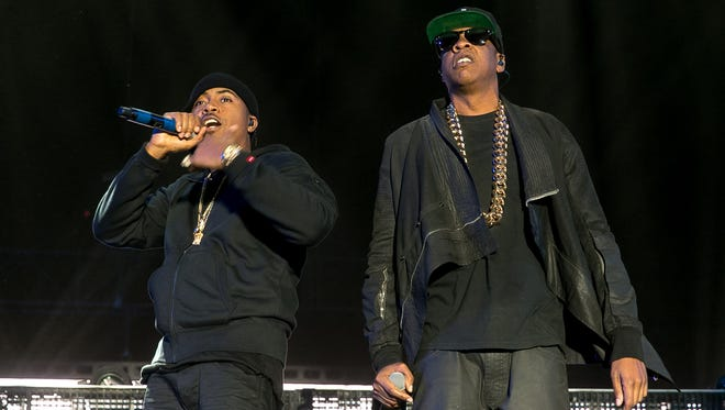 Jay-Z (right) performs with NAS at the Outdoor stage during Coachella Music & Arts Festival Weekend 1 held at Empire Polo Club in Indio on Saturday, April 12, 2014.