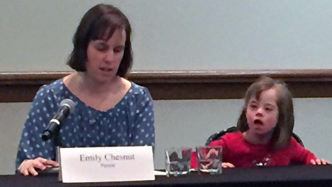 Emily Chesnut of Milford, Ohio, and her daughter Nora speak at a Feb. 15, 2018, press conference against a ban on abortion following a Down syndrome diagnosis.