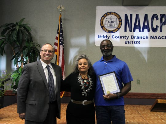 Jeff Diamond and city councilor Lisa Anaya Flores and New Mexico NAACP president Daniel Johnson pose with a proclamation from Carlsbad Mayor Dale Janway. Diamond was also recognized by the Eddy County NAACP for his leadership and service to the community.