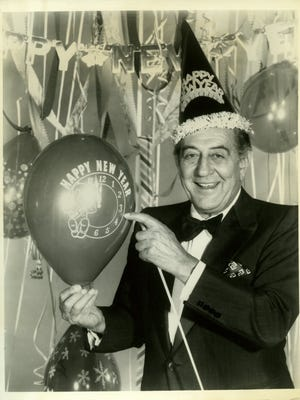 Guy Lombardo preparing for the New Year. This image was distributed as part of a promotion for the worldwide satellite telecast of his 1975 New Year's Eve event.