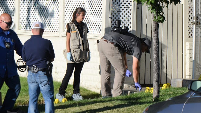 Crime scene investigators work outside a home on the 1700 block of London Circle in Sparks after an officer involved shooting on Tuesday, July 17 left one suspect dead.