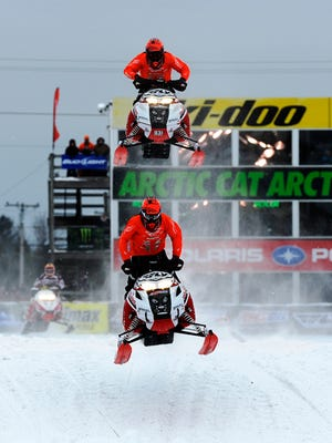 Todd Corin (136), and Trevor Leighton (931), top, both of Eagle, Ind., lead the field in the Pro Open Sno-Cross Championship, finishing first and second, respectively, at the 51st annual World Championship Snowmobile Derby in Eagle River on Jan. 19, 2015.