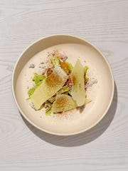 Frozen avocado with candied orange, shards of white