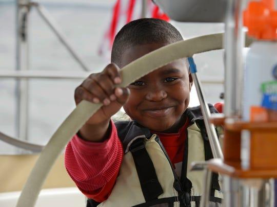 Ryan Williams takes the wheel of the sailbaot Satori,