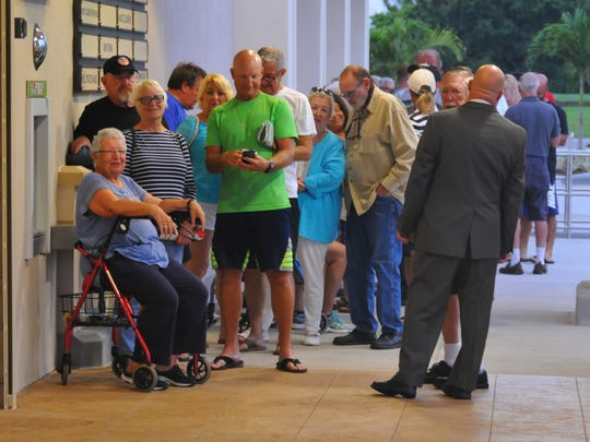 """Store manager Billy Wiles chats with the people in line before they opened the """"new"""" Publix in Cocoa Beach. It opened at 7 a.m. sharp May 31, 2018, with customers lined up in front of the store. The store closed shortly after Hurricane Irma, was torn down, and was rebuilt bigger and better."""