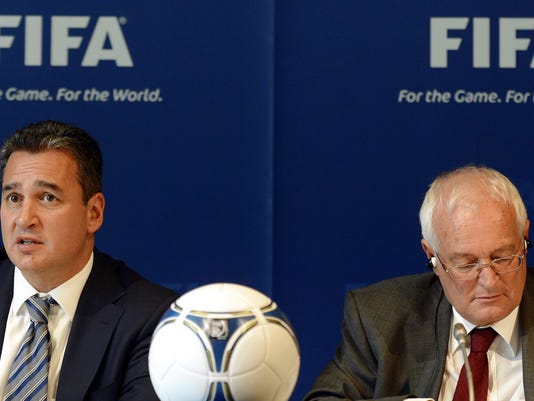FILE - In this Friday, July 27, 2012 file photo, Chairmen of the two chambers of the new FIFA Ethics Committee Michael Garcia, left, from the US and Joachim Eckert, right, from Germany attend a press conference, at the Home of FIFA in Zurich, Switzerland. FIFA ethics judge Joachim Eckert is unlikely to reach final decisions in the 2018 and 2022 World Cup bidding corruption probe until early next year. The German judge also suggested on Friday, Sept. 19, 2014, it was not his job to remove Russia or Qatar as hosts or order a re-vote based on FIFA prosecutor Michael Garcia's investigation. (AP Photo/Keystone, Walter Bieri, File)