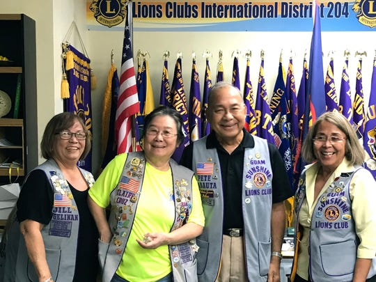 Guam Sunshine Lions Clare Cruz, (2nd from left), and Pete Babauta received their Progressive Melvin Jones Pins during the club's general membership meeting on Oct. 17. Recognition as Progressive Melvin Jones Fellows signifies their additional contribution of $1000 each to the Lions Club International Foundation, that supports humanitarian services such as blindness prevention, hunger relief, disaster relief, help for the disabled, and youth education and development, etc. Lion Jill Pangelinan, Membership Director (far left), and President Rosie Matsunaga, (far right) presented the pins.