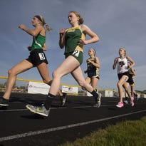 Runners head down the backstretch during the girls 1,600 in a WIAA Division 1 regional meet last week at Wausau West