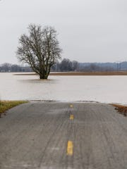 A section of Duesner Road is flooded in the Union Township area of Vanderburgh County, Thursday, Feb. 22, 2018. The National Weather Service has issued a flood warning for Southwest Indiana because a total of 4 to 7 inches of rainfall is likely in the area through late Saturday night.