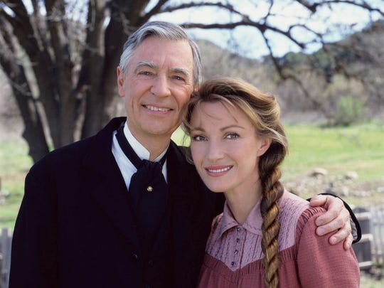 "Dr. Mike (Jane Seymour) welcomes the Rev. Thomas (guest star Fred Rogers) to Colorado Springs on ""Dr. Quinn, Medicine Woman"" in 1996."