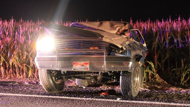 The passenger side headlight remains lit after a rollover crash Sept. 14, 2014, that occurred when a 16-year-old lit the driver's armpit hair. Five teens were in the SUV; three were injured.