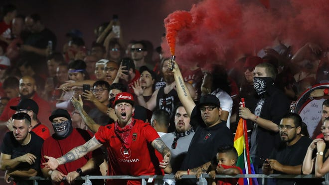 Phoenix Rising fans protest a goal being taken away after a mad scramble and collision near the net against Sacramento in the first half at the Phoenix Rising Soccer Complex in Tempe, Ariz. on May 19, 2018.
