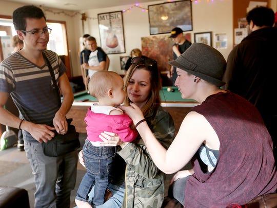 Debora Lascelles (middle) holds daughter Ellie, 1,