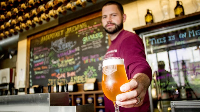 Bob Wagner, operations manager at Backpocket Brewing Co. serves an IPA at the brewery in Coralville, IA on Thursday, May 15, 2014.