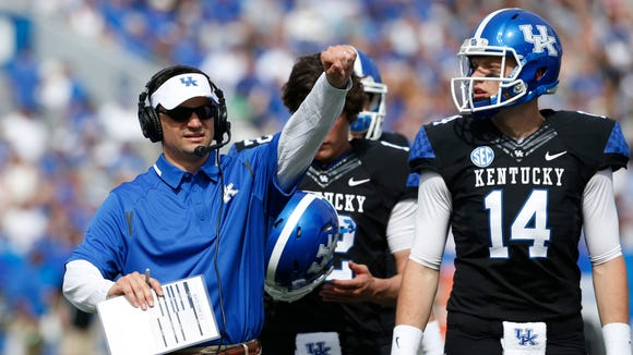Kentucky Offensive Coordinator/Quarterbacks Coach Neal Brown during the first half the annual Blue White spring football game at Commonwealth Stadium in Lexington, Ky. April 26, 2014