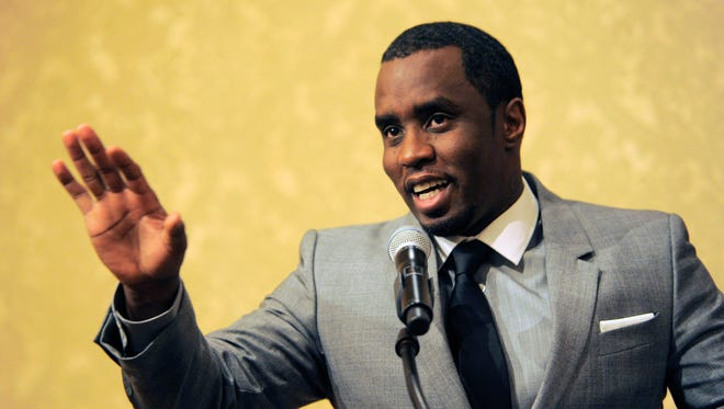 """In this July 26, 2013, file photo, Sean """"Diddy"""" Combs addresses reporters at the Beverly Hilton Hotel in Beverly Hills, Calif."""