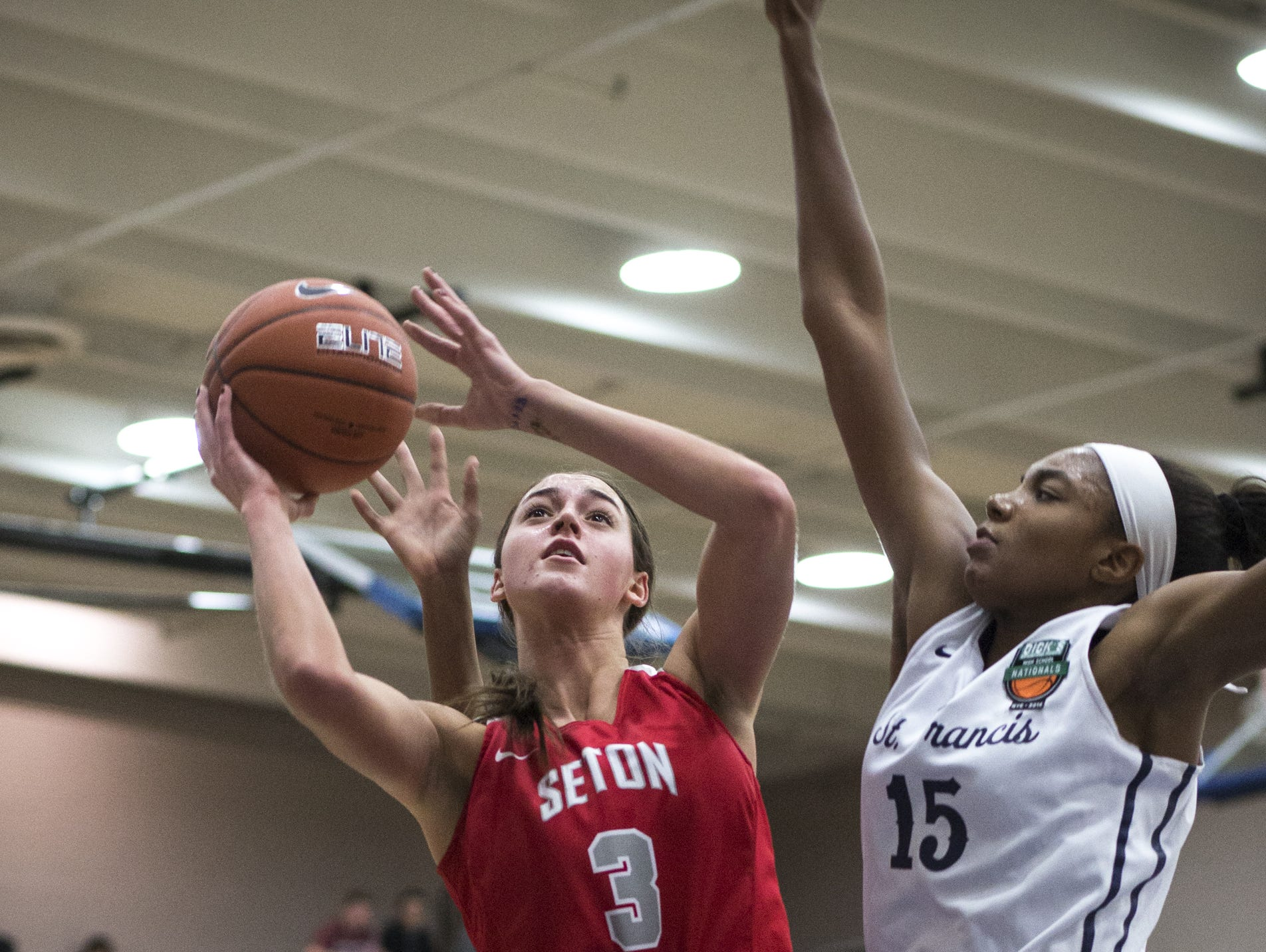 Jennifer Wirth (left, Seton Catholic) takes a shot against Maya Dodson (St. Francis), December 19, 2016, during the Nike Tournament of Champions (Joe Smith bracket) game at Mesquite High School, 500 S. McQueen Road, Gilbert.