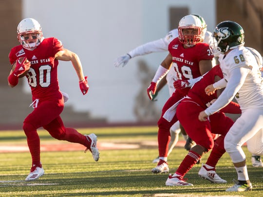 Southern Utah University's Judd Cockett (80) returns a kick for a touchdown against Sacramento State at SUU Saturday, October 13, 2018.