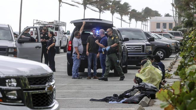 Palm Beach police, Border Patrol, Palm Beach County sheriff's deputies and West Palm Beach police detain migrants suspected of attempted to illegally enter the country by boat. They were caught in the 900 block of North Ocean Boulevard Friday morning. By day's end, 12 people were in custody.