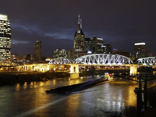 The Shelby Street pedestrian bridge spans the Cumberland River in Nashville, Tenn. The banks of the Cumberland River are more than a place to watch barges pass. The bridge is one of the best viewpoints for the Nashville skyline that inspired Bob Dylan to write a country album.  AP This Jan. 15, 2014 photo shows the Shelby Street pedestrian bridge spanning the Cumberland River in Nashville, Tenn. The banks of the Cumberland River in downtown Nashville are more than a place to watch barges pass. The bridge is one of the best viewpoints for the Nashville skyline that inspired Bob Dylan to write a country album. (AP Photo/Mark Humphrey)