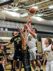 Hartland's Will McCoy (25) contributed four first-quarter