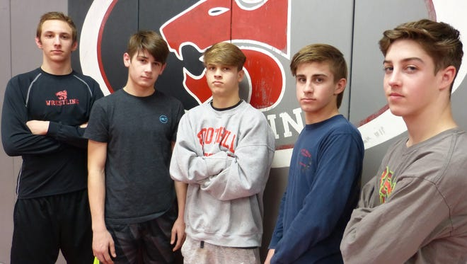 Foothill High wrestlers Russell Rucklos, from left, Cory Williford, Dalton Lakmann, Tucker Ellis and Colton Stone compete in the CIF state championships Friday in Bakersfield. The five Cougars are the most the program has sent to state since 2007.