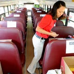 Beverly Bumbarger, a volunteer from the Target store, helps during the 2012 United Way Stuff the Bus school supply drive. This year's drive is Aug. 6 from 8 a.m. to 6 p.m. at Target and Wal-Mart in Great Falls.