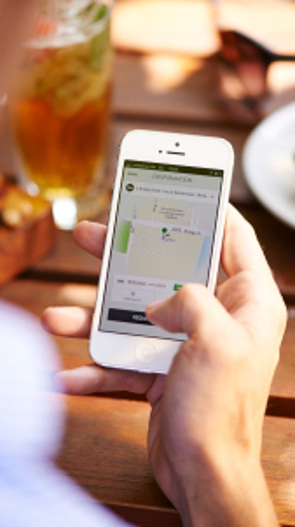 Users of the Uber app can request a registered driver to pick them up.