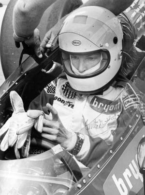 Janet Guthrie puts on her gloves for the first time on the Indianapolis Motor Speedway track in 1976.