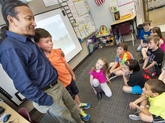 Dorje Gurung gives Harrison Mabon, 8, a hug while visiting a class at Friendship Elementary School in Codorus Township. Harrison's father, Bill, was one of Gurung's college friends. The man has been visiting this country trying to raise funds and bring awareness to the poor conditions of elementary schools in Nepal and was in York County when the earthquake hit his homeland.