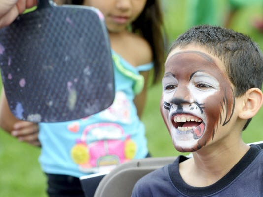 Yoskar Raenoso, 9, is all smiles as he looks in the mirror at his face after it had been painted to look like a dog. The Education First Parade and Rally served as a way to celebrate and rally support for the York City School District.