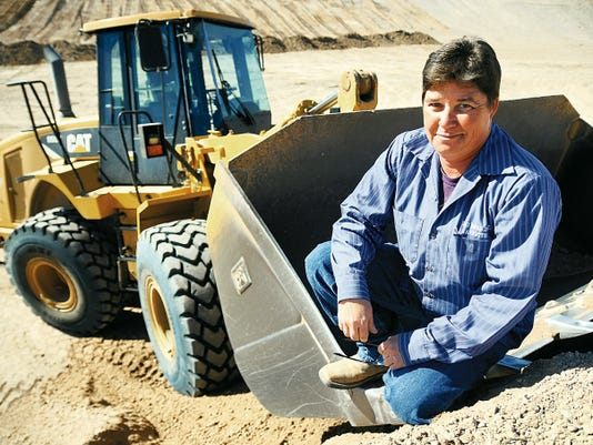 Doña Ana County heavy equipment operator Annette Forman sits on her truck loader Wednesday at the gravel pits near the Hill Transfer Station. Forman makes 21,466.