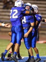 Lake View's Frank Muniz, left, hugs quarterback Henry