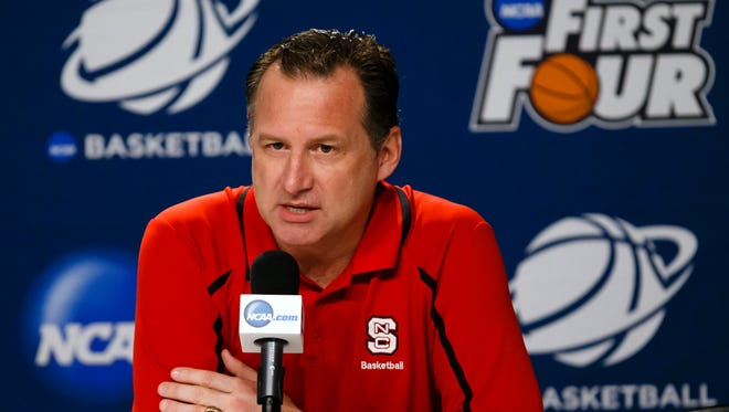 North Carolina State Wolfpack head coach Mark Gottfried takes question from the media before practice the day before the first round the NCAA tournament at UD Arena.