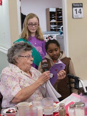 The girls gifted senior citizens with candy and homemade cards during their dinner hour on Valentine's Day.