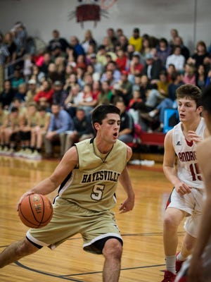 Josh Cottrell drives to the basketball during a game against Andrews