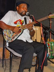 """James """"Super Chikan"""" Johnson brings his band and handmade guitars to The Bradfordville Blues Club on Friday."""