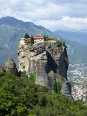 Monastries built on high pinnacles in the 14th Century were to escape Ottoman Turks in the Meteora, Greece area.