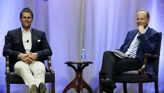 New England Patriots quarterback Tom Brady sits down for an event moderated by sportscaster Jim Gray (R) at Salem State University in Salem, Mass.