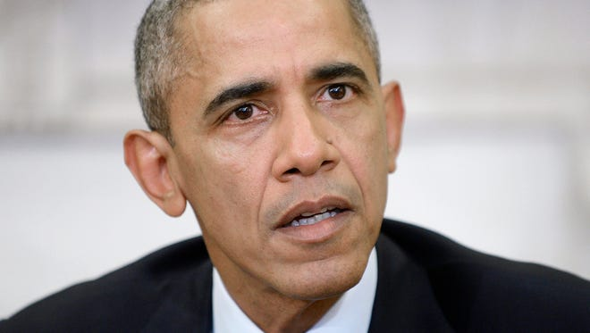 President Obama makes a statement on the San Bernardino shooting in the Oval Office Dec. 3. The White House announced Wednesday that Obama would travel to San Bernardino Friday.