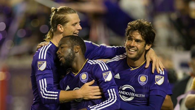 Orlando City midfielder Kaká, center, celebrates with midfielder Kevin Molino, right after a goal in their last home game against Portland.