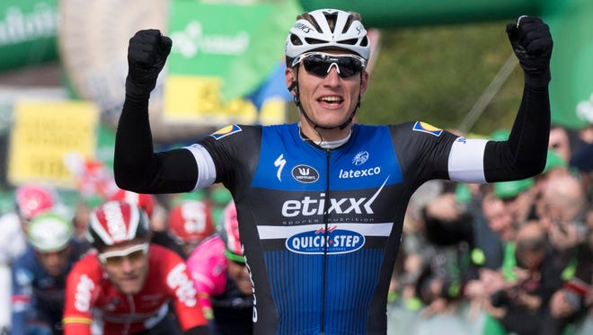 Germany's Marcel Kittel of team Etixx-Quick Step raises his arms after crossing the finish line to win the first stage, over 100.5 km between Mathod and Moudon, of the 70th Tour de Romandie on April 27.
